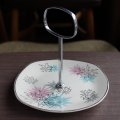 "Midwinter ""Quite Contrary"" plate with handle/fitting"