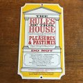 """The Rules of This House"" enamel sign"